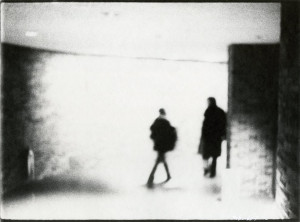 Two Figures in Silhouette Subway