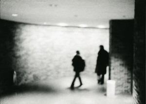 Two Figures in Silhouette in Subway